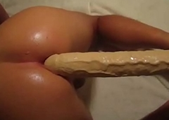 Enormous Dildo In Lubed Tranny Ass
