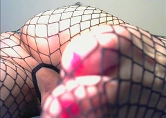 closeup of my ass with an increment of hooves in fishnet