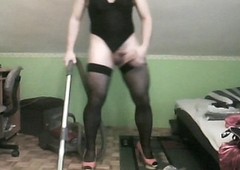hoovering in sexy lace-work leotard